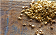 Gold hovers near 5-week low; political tensions support